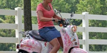 Kate Gosselin on moped