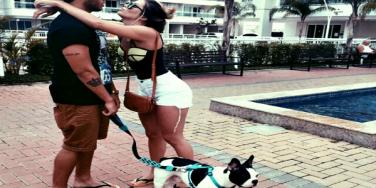 Man, woman and dog.