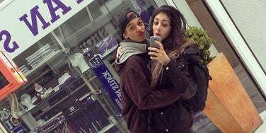 Couple on a date making duckface in a selfie