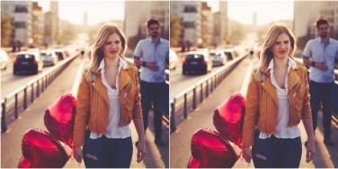 woman holding heart balloons walking away from man