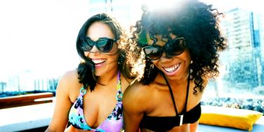 two friends laughing in bathing suits