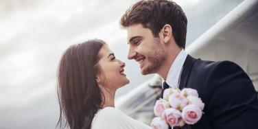 couple smiling at each other on their wedding day