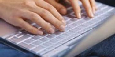 typing hands keyboard laptop