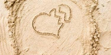broken heart drawn in sand