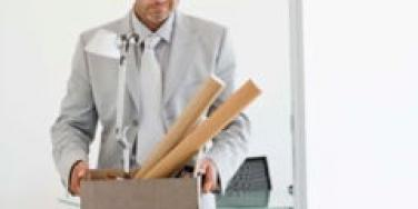 man-in-suit-carries-office-supplies