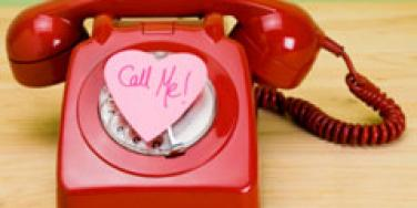 red rotary phone with call me heart shaped post it