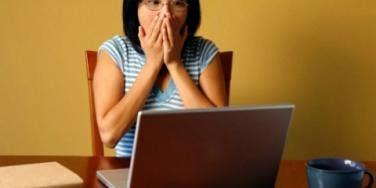 woman gasping at computer