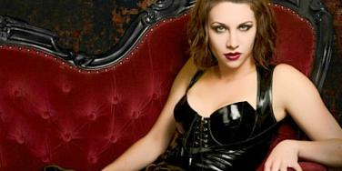 sexy woman black leather catsuit reclining