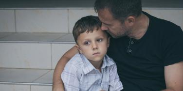 grieving father and son