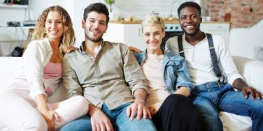 two men and two women sitting on couch