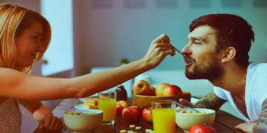 couple eating a meal she cooked for her boyfriend