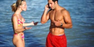 Couple arguing on the beach