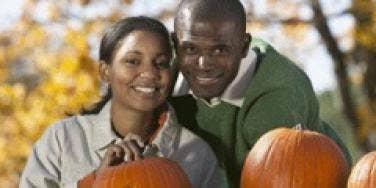 couple carving pumpkin