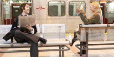 man and woman at a subway station