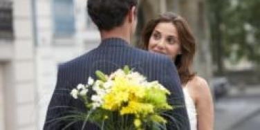 couple meeting for date outside surprise with flowers