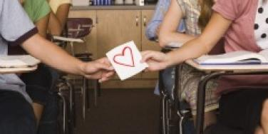 Couple passing notes in class