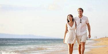 couple walking a beach