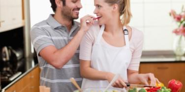 couple happy cooking