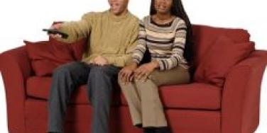 Couple on couch not talking
