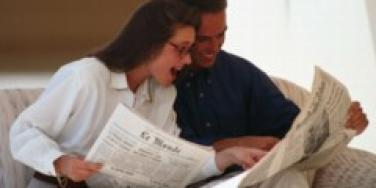 couple reading paper
