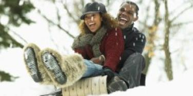 couple sledding in snow