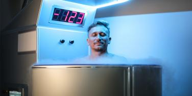 man in cryotherapy chamber