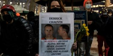protestor holding sign about convicted former police officer Derek Chauvin
