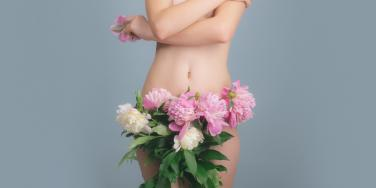 flowers covering woman vagina