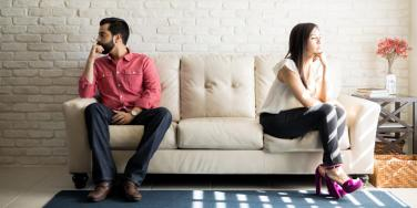 couple sitting on opposite ends of the couch