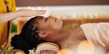 woman receiving Reiki energy healing