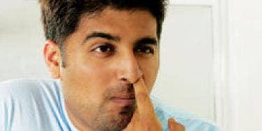 indian man picking his nose