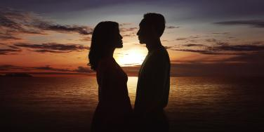 couple silhouette in front of the sunset