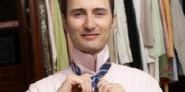 man tying tie