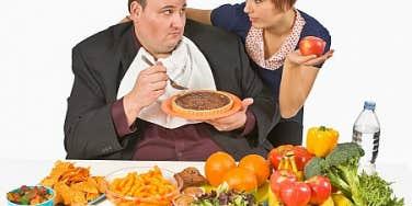 Fat man chooses unhealthy food