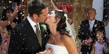 flower petal throwing at bride and groom