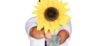 man holding giant sunflower
