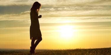woman walking sunset