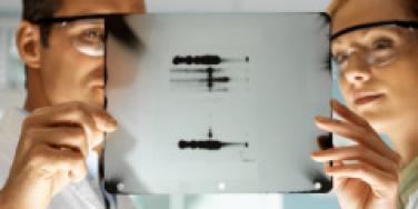 male and female scientist examine dna results