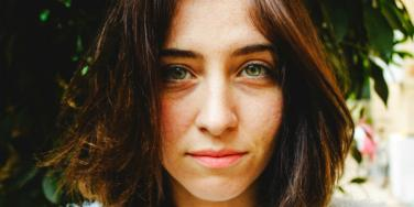 woman with green eyes staring forward