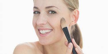 Girl putting on make up