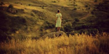 girl standing on the plains