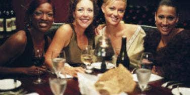 Four women enjoying drinks