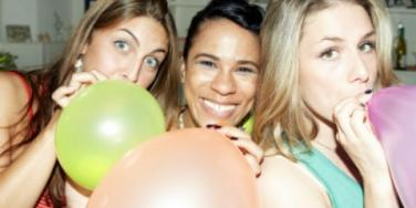girls blowing up balloons