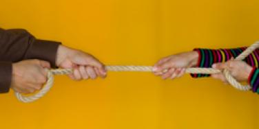 tug of war giving and taking