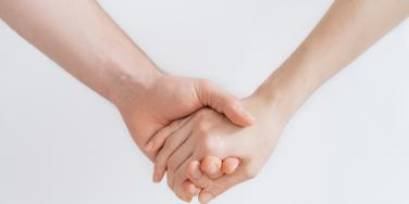 two caucausian hands, clasped