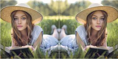 mirrored image of woman reading on the grass