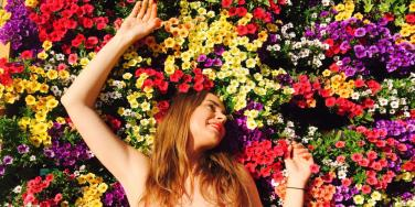 young woman laying in flowers