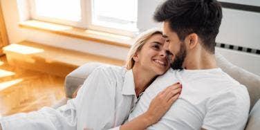 woman cuddling with man