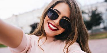 woman with sunglasses smiling