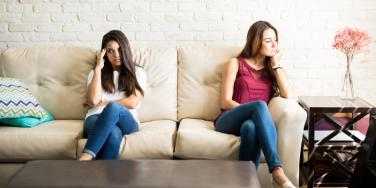 woman sitting away from each other